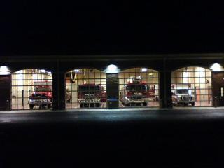 Paxton Fire Station - Fire Trucks inside at Night